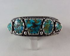 Rich deep colored Nevada tuquoise is set in a sterling silver cuff bracelet by Navajo artist Fred Thompson.