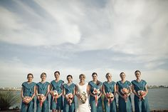 Pretty bridesmaid dresses with a nautical feel to them.