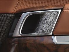Acanthus scroll work turns the internal door handles into works of art