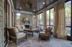 burlap drapes on screened in porch...maybe for pool lanai?