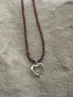 Garnet and Sterling Silver Heart Necklace by smisko on Etsy, $66.00