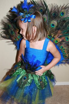 Super cute peacock costume for a little girl.