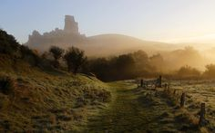Corfe Castle in the mist. Picture: Glyn Thomas / Rex Features