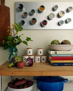 kitchen storage: numbered jars and magnetic wall mount with storage containers attached