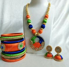Buy silk thread bangles new design, silk thread necklace, silk thread earrings and jhumkas online. Customized Silk Thread jewellery set at best affordable prices for women's jewellery shopping online. Silk Thread Earrings Designs, Silk Thread Bangles Design, Silk Thread Necklace, Thread Jewellery, Fabric Jewelry, Diy Jewellery, Flower Jewelry, Jewelry Shop, Jewelry Design