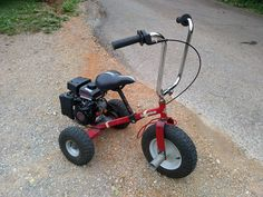 Motorized tricycle. Another one of my projects. It has a 79cc Predator. I'm building this just to ride around the car shows still have a little more work to go on it.