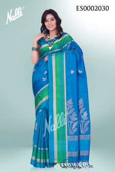 Peacock Blue Soft Silk Saree, zari flower designs on the body and borders of the saree. Includes unstitched blouse.Please send an mail to eshop@nalli.com for more details or visit http://www.nallisilks.com/store/sarees/party-wear/soft-silks to see more collections.