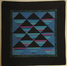 Amish Blues quilt by Anne Turner