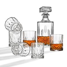 Studio by Godinger Diamond Decanter and Whiskey Glass Set. Can be used for wine, scotch, bourbon, vodka, juice and water. This is a great set to have on hand for any entertainment occasion. Whiskey Decanter, Whiskey Glasses, Stemless Champagne Flutes, White Coasters, Square Dinnerware Set, Glass Bar, Crystal Decanter, Cocktail Glass, Bar Set
