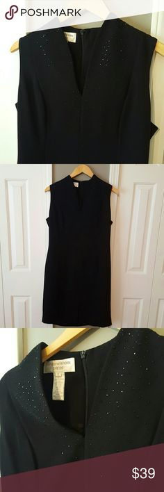 """Black cocktail dress Jones New York, black cocktail dress.  Small slit in the front.  Zips up the back.  38"""" from shoulder to hem.  Fully lined.  Beading around neck line. Excellent condition!  Worn 1 time for a wedding. Jones New York Dresses"""
