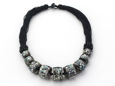 Wheel Shape Black Mosaics Shell Necklace with Black Thread: http://www.aypearl.com/wholesale-shell-jewelry/wholesale-jewellery-X347.html