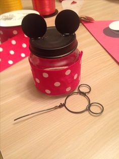My DIY party favor: Mickey Mouse bubbles! Made from baby food jar, jewelry wire and ribbon.