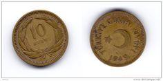 """Antiga Lira turca (1923-2005) (x) 10 kurus (1949-1956) O: lua crescente e estrela símbolos do islamismo, e em turco """"República da Turquia""""/R: valor e alguns ramos."""