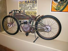 """Built around a Chinese 2-stroke engine using 26"""" bicycle wheels. One of the nicest I have seen. He really captured the propor..."""
