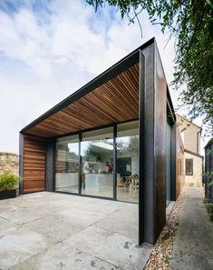 Architect Henry Goss has completed a rusted steel and timber-clad extension to a house near Cambridge, England, two years after Dezeen published the hyper-realistic renderings that changed his life House Cladding, Timber Cladding, Facade House, Residential Architecture, Architecture Design, Steel House, House Extensions, Prefab Homes, Modern House Design