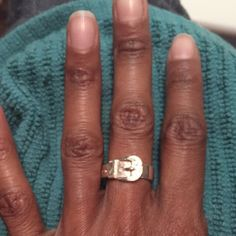 100% Authentic Sterling silver ring Authentic vintage sterling silver buckle ring. Very nice! The first picture is my left hand ring placement, and the third picture is my right hand ring placement. I have small fingers so I think it's about a 51/2-6. Jewelry Rings