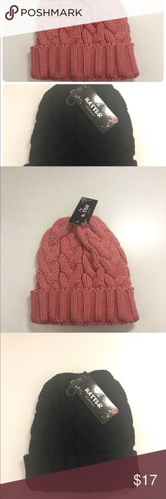 2- in -1 Cable Knit Beanie Cuffed Beanie adjustable to ponytail.  Made of knitted material. The Hatter Accessories Hats