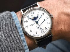 Hands-on review & original photos of the Breguet Classique 7787 watch with price, background, specs, & expert analysis.