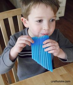 This straw pan flute is so easy to make that kids can make it all on their own! You just need straws, tape, and scissors.
