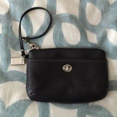 Black leather Coach wristlet Coach wristlet in black leather with beautiful emerald lining. Turn-lock outer pocket and one interior pocket. Never used, excellent condition. Coach Bags Clutches & Wristlets
