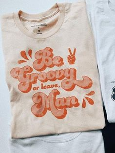 Be groovy or leave, man. With every purchase, we donate 10% of profits to Mental Health America.  Care/Content 100% Soft cotton Soft cream color Unisex sizing S M L XL 2XL Width, cm 45.7 50.8 55.9 61 66 Length, cm 71.1 73.7 76.2 78.8 81.3 Sleeve length, cm 22.6 23.3 24 24.7 25.4 Vintage Outfits, Vintage Fashion, Vintage Style, Camisa Vintage, 70s T Shirts, Men Shirts, T Shirt Designs, Cute Tshirts, Graphic Shirts
