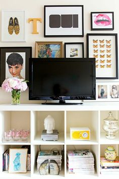 Tiffany Leigh's Toronto Studio Tour // cube storage // flat screen TV stand // tv and gallery wall // apartment small living room organization