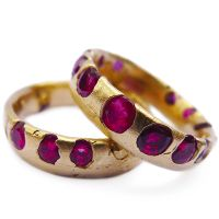 Polly Wales Fine Jewellery bands in 18k gold with 2 cts. t.w. rubies; $3,200 each #PollyWales #gold #rubies