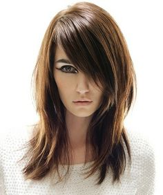 Love the side bang! Medium Length most suited for a square face shape.