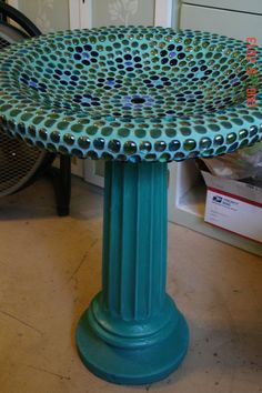 Mosaic Concrete Birdbath with a teal base and green, blue and purple glass nuggets with a specialty mixed colored grout on the top. The bottom is a Mosaic Tile Art, Mosaic Birds, Mosaic Crafts, Mosaic Projects, Mosaic Glass, Stained Glass, Concrete Bird Bath, Concrete Crafts, Mosaic Birdbath