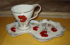 red floral cookie jar | ... in retro style, white ceramic cup and plate set with red flowers