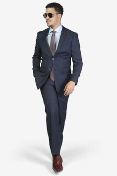 Suit includes jacket & trousers 2-button single breast jacket Notch lapels Flap pockets Side vents Suit includes jacket & trousers Fit: Slim Fit Comfort: Stretch Armhole for comfort Material: 98% Wool 2% Spandex Color: Blue Windowpane