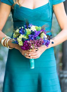 Purple and blue bridesmaid bouquet | Jewel Tone Wedding Florals That Really Rock via @IBTblog