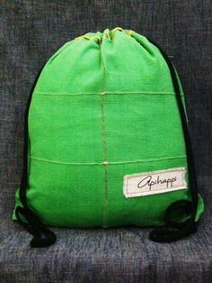 A unique handloom, Stringy bag from Sri Lanka - in Leaf Green with Yellow piping and Black string - The Kermit