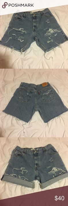 """Levi's Distressed High Waisted Cut Off Shorts Authentic Levi's. Zip fly. Distressing. Inseam is cut to about 6"""". These shorts are extremely comfortable and worn in. Marked as a 14, but fit much smaller. Look great worn high waisted! Would best suit a looser size 8 or more fitted size 10. They give off a very grungy vibe and are perfect to pair with any summer outfit. Look super cute rolled up as well and will only get better with age! Levi's Shorts Jean Shorts"""