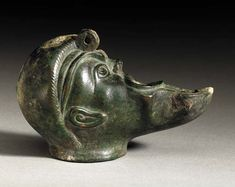 Bronze oil lamp, circa century A. Dimension: 4 in. A half lamp, in the form of the proper right half of a theater mask, with a megaphone-like mouth. Ancient Near East, Ancient Rome, Ancient Greek, Roman Artifacts, Ancient Artifacts, Pompeii And Herculaneum, Archaeological Discoveries, Greek Art, Old Art
