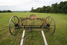 Old 3-horse-drawn hay rake