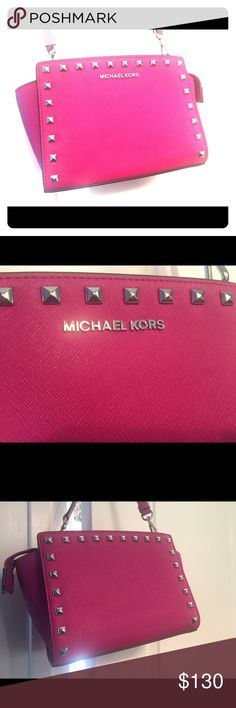 Auth. MICHAEL Kors Selma Stud Hot Pink Crossbody💗 Authentic MICHAEL Kors Studded Hot Pink / Fuchsia/ Silver Stud Crossbody Bag! Gorgeous Bag!! Adorable with jeans or a dress! Great size for shopping or a night out! Excellent condition! I carried maybe once or twice shopping. 💗 Michael Kors Bags Crossbody Bags