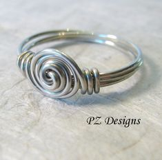 A Simple Wire Ring 2019 Simple Wire-Wrapped Ring. Tutorial Shows Step By Step Instructions. Love This Simple Ring Wire Jewelry Tutorials The post A Simple Wire Ring 2019 appeared first on Metal Diy. Metal Jewelry, Jewelry Rings, Jewelery, Jewellery Box, Silver Jewelry, Jewelry Knots, Amber Jewelry, Jewellery Shops, Silver Rings