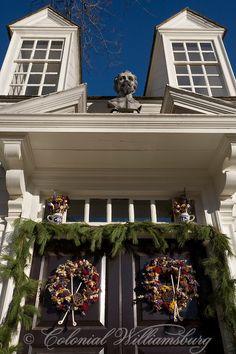 The Raleigh Tavern decorated for the  Christmas season. Double doors - double wreaths--Williamsburg, Virginia