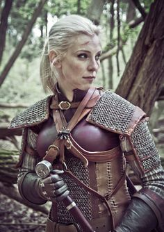 This female Geralt cosplay by Aelirenn is absolutely stunning. The costume is the real deal too. She made the leather corset herself while the chain mail was crafted by historical costume makers.