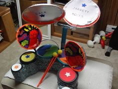 I made this drum set for my 3 year old grandson out of plastic coffee containers, duct tape, aluminum cake pans, paper plates, ice cream buckets.  What fun!