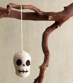 Need some Halloween decorating ideas?  This skull ornament would look great hanging from trees or on a porch!