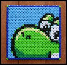 Tetris Attack: Yoshi perler beads by riotpatch, via Flickr Yoshi, Pearler Beads, Fuse Beads, Hama Beads Patterns, Beading Patterns, Perler Coasters, Perler Bead Mario, Kawaii Cross Stitch, Faith Crafts