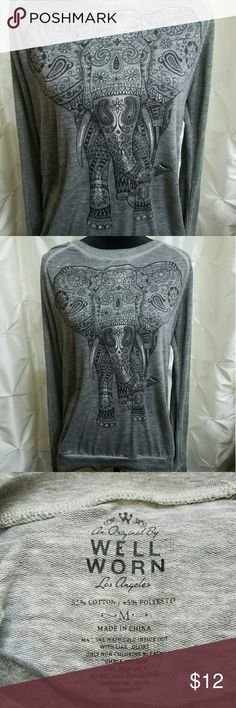 """An Original by Well Worn Elephant longsleeve shirt Well worn elephant print longsleeve shirt. Lightweight material made with 55% cotton and 45% polyester. Armpit to armpit 20', length 26"""" sleeve length 32"""" Well Worn Tops Tees - Long Sleeve"""