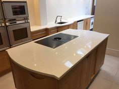 This wood style kitchen oozes with style with the Bianco Minerale style quartz. The colours go perfectly together and make a modern yet traditional style hub of the home. #BiancoMinerale #WhiteQuartz #QuartzWorktops #WhiteWorktops