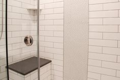 Shower and Wall Tile: Angora 4x16 Glossy Tile, White; Shower Accent: Angora Soho 3/4 Penny Round Glossy, White; Bathroom Floor Tile: Italia 3x12, Natural; Grout: Timberwolf