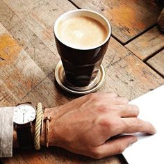 Productivity with a cup of coffee and a Daniel Wellington watch