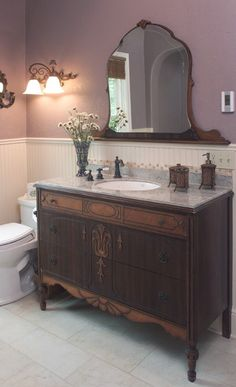 Using an old dresser as a bathroom vanity. Notice the mirror is detached from the dresser and placed on the wall.