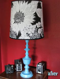 Ugly lamp turned pretty with spray paint and fabric over the shade. Love!