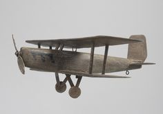 "Unusual Folk Art Bi-Plane Weathevane (Sold) Hand Carved and Painted Wood with Metal Details  English, c.1935  6.00"" high x 20.00"" wide x 16.00"" deep"